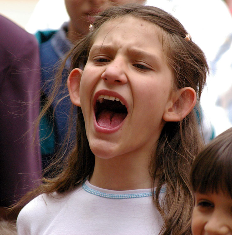 Photo of girl shouting.